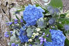 Vintage blue bouquet from OK Bouquet - Hydrangeas, Supernova Thistles, Snowberries, Gentiana and Eucalyptus