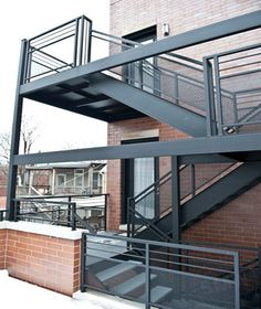 A custom commercial modern metal porch with a perforated railing in Roscoe Village for an apartment building.