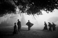 Mist and Monks | From the photo essay Monks of Chimi Lhakhang, image number 001-1DM40131 | Chimi Lhakhang is the known as the Temple of the Divine Madman. Phallic symbols dominate the entire area let alone the temple, as the founding monk had something of a passion for women. To this day the blessing from monks at Chimi is known to bring good luck to those seeking to have a baby. For our photography tour it just brought us some lovely photos of monks and their traditions.