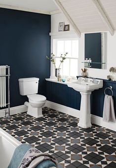 Don't be afraid to experiment with dark colours in your bathroom. Dark blue walls can add a stylish and elegant appearance to any bathroom design. Pair with traditional fixtures to make a strong visual statement.  . #wholesaledomestic #bathrooms #bathroomdecor #bathroomdecorating #darkinteriors #traditionalbathroom #vintagehome #bathroomrenovations #bathroommakeover #bathroominspiration #bathroominterior #dreambathrooms