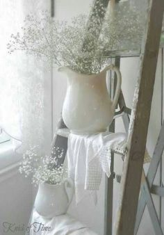 Iron stone pitchers with baby's breath white on white