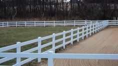 Tri-Boro Fence installed this white PVC / Vinyl 3-rail ranch rail fence surrounding the pastures and riding ring of this farm in Bath, PA