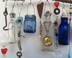 Example of Made when ordered Bottle Chime/Vintage Bottles Embellished with Found Objects, buttons beads, etc. Altered Bottles, Old Bottles, Vintage Bottles, Glass Bottles, Antique Bottles, Vintage Perfume, Antique Glass, Perfume Bottles, Diy Bottle