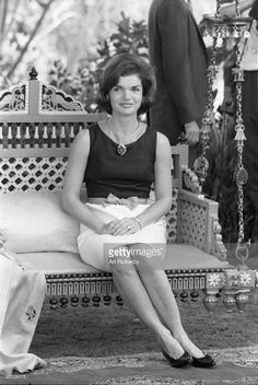 Portrait of American First Lady Jacqueline Kennedy (1929 - 1994) as she sits on a chair swing during a State Visit to Delhi, India March 1962.