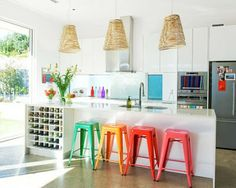 How some colorful chairs can really spark a simple kitchen. Love!