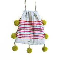 FLOWER CROWN // GAIA pom pom bags are made from vintage + repurposed fabric by resettled refugee women living in Dallas //   www.gaiaforwomen.com