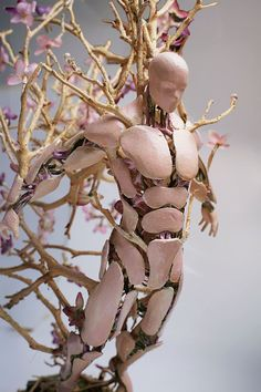 Assemblage artist Garret Kane just unveiled this new series of figurative sculptures depicting fractured individuals who appear to merge with the seasons. Each piece was first partially designed using digital sculpting software called Zbrush, and then 3D-printed components were affixed to wood, rock