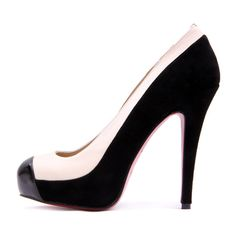 White and Black Stitching Pump.....i would wear these shoes like crazy...