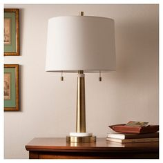 Franklin Table Lamp - Brass - Threshold™ : Target ...Rich in depth and lean in shape, the Franklin Collection Table Lamp brings incandescent style to your living room or bedroom. Combining a rounded brass post, white accents, 2 chain pulls and a stable tiered foot, this colonial style lamp is capped off with a simple white shade for complete elegance. Pair with a wide variety of furniture styles for a versatile lighting option you'll love. $53.99