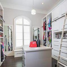 Walk In Closet with Ladder on Rails