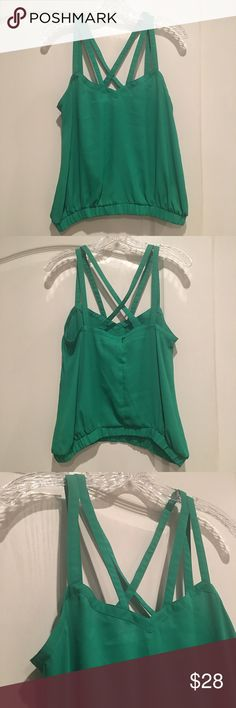 ASOS Kelly Green Blouse V Neck with double Criss Cross Straps and an elastic banded waist. The color is more of a Kelly Green than it appears in these photos ASOS Tops Blouses