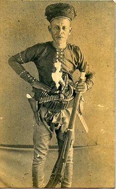 Hadji Abdullah of Jolo, Philippines with a pearl-handled revolver and Krag gifted by Taft. The white shape at his solar plexus is a finely carved and stylized ivory kakatua pommel of his Kris, of high status. American War, American History, Filipino Tribal, Filipino Culture, Mindanao, Rough Riders, Asia, Historical Photos, Indie