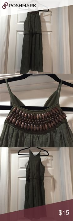 Olive green sundress Lightly used mini dress for summer. Olive green in color with a decorative neckline. Dresses Mini