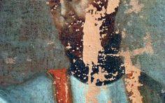 Detall de la cara del sant estucada i començant el retoc amb puntillisme