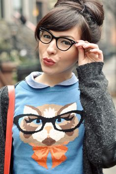 Who says you can't match your glasses to your outfit? Keiko of Keiko Lynn looks lovely in cat-eye specs and the Cat Eyeglasses Sweater from ModCloth!