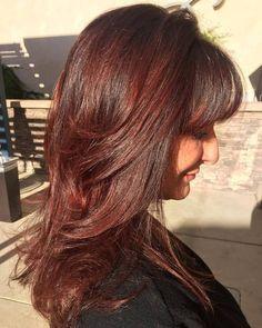 long layered haircut with bangs