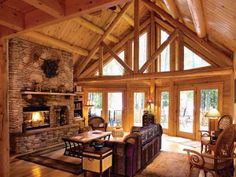 I like the chunky wood frames on the windows but could go without the exposed beam triangle thing. add more warmth too!
