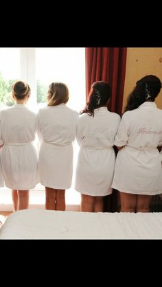 My mum made these as part of the bridesmaids presents. White dressing gown and then she ironed on gems from left to right : Bride to be Mother of the bride Chief Bridesmaid Bridesmaid Great for when everyone was getting ready and a fab keepsake!!!!