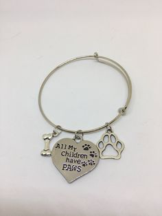 Pet charm bangle bracelet by Pinkarrowheadranch on Etsy https://www.etsy.com/listing/511211340/pet-charm-bangle-bracelet