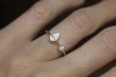 Simple, beautiful and unique handmade round and pear-shaped Diamond ring.  Product details First stone (pear-shaped) Gemstone: Diamond (Other gemstones