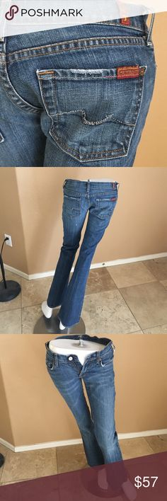 Women's 7 For All Mankind Jeans! 100. Authentic Womens 7 For All Mankind Dark Wash Jeans! Size 26, 98% Cotton, 2% Pokyurethane. In excellent condition only worn a couple times, slight wear pictured at Heels! 7 For All Mankind Jeans Boot Cut