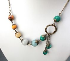 Teal and Saffron Asymmetric Necklace with Jade and Crystal Accents from http://www.etsy.com/shop/BevaStyles