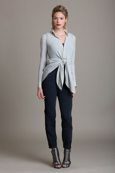 """Product Description  This stretch georgette convertible blouse can be worn at least 5 different ways. Wear it how it looks best on you! Double side back drawstrings Button front Style #: BL3861 Model is 6'0""""  Colors shown: Quinoa Also Pictured:Tailored Drape Tuxedo Pant Size Chart:    US Size Center Back Length Chest Waist   0 29 1/8 42 3/4 53 3/4   2 29 1/2 44 55   4 29 7/8 45 1/4 56 1/4   6 30 1/4 46 1/2 57 1/2   8 30 5/8 48..."""
