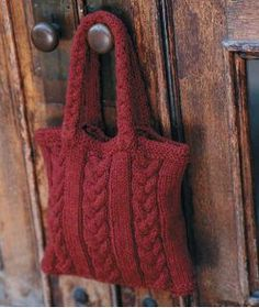 This gorgeous Cabled Bag is the perfect project for a chilly autumn weekend.  Knit in the round with alternating rows of braided cables and stockinette stitch, this pattern will keep your mind engaged and will result in a stylish knit handbag you can wear throughout the season.  Finally you'll have your own go-to purse that can safely stow all of your essentials in one convenient place.