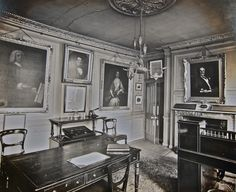 The Directors' Room with portraits of William Caslon and Elizabeth Caslon.
