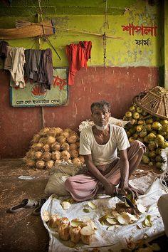 selling coconuts, Dhaka, Bangladesh