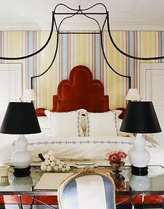 colorful stripes and velvet headboard in bedroom ~ Miles Redd design