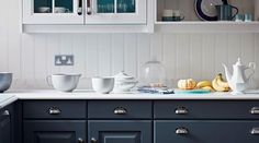 The classic Original Artisan kitchen from John Lewis of Hungerford. This kitchen installation in Wales combines a classic cabinetry style with soft, contemporary colours to create a calm and relaxed atmosphere in this kitchen. The client's beautiful Aga is a strong contrast to the mid-tone blue cabinets, without being overpowering. There are some clever details to add more interest to the scheme with the more vibrant green/blue inside the larder, and the polished chrome handles.