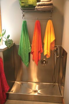 Does your laundry or mud room need a dog-washing station? This one features a stainless steel shower pan and walls.