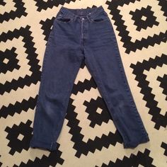 Vintage Levi's High-Waisted Mom Jeans Vintage 90's Levi's. Soft, truly blue faded blue jeans. Rad with crop tops and tanks. Great staple pants for the spring. Levi's Jeans Boyfriend