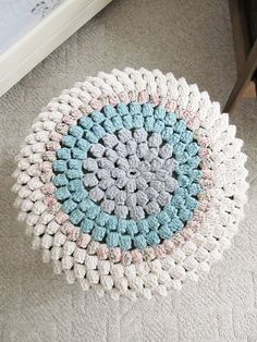 ta dah!  a 'lo and beholdness' circle of crocheted goodness  becomes a 'lo and beholdness' warm and woolly coat for a cold mid century stool...
