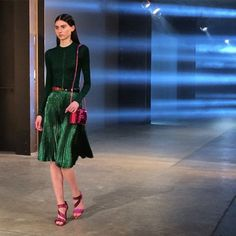 Emerald elegance punctuated by hot pink accessories - a new after-dark duo at #ChristopherKaneStudio #FW15 #LFW #regram #PORTERMagazine
