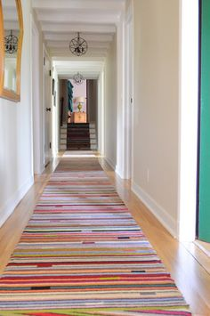 how and where to use stripes make a hallway seem endless by using a stripe