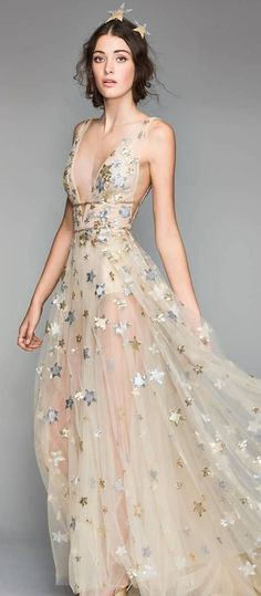 Celestial Inspired Wedding Dress by Watters. Sleeves a line ethereal bridal gown deep v neckline with gold stars. #weddingdress #weddingdresses #bridalgown #bridal #bridalgowns #weddinggown #bridetobe #weddings #bride #weddinginspiration #dreamdress #fashionista #weddingideas #bridalcollection #bridaldress #fashion #dress See more gorgeous bridal gowns by clicking on the photo