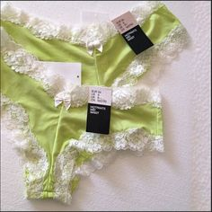 2 Pairs Satin & Lace Hot Pants Lingerie H&M Lime Green Hot Pants Mid-waist Lingerie. Satin body with White lace trim. Two available. Size 4 & size 6. Matching Cotton lining at inside center. Brand New with tags attached. Fabric content: 76% polyamide, 24% elastane, machine wash, line dry. Each retails at $7.95. Measurements to be added. Price is for both. Will sell individual for $5 & Will bundle! H&M Accessories