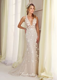 Enchanting By Mon Cheri 217109 - Sleeveless tulle, chiffon and lace over charmeuse fit and flare gown, illusion extreme deep V-neckline and bodice accented with three-dimensional flowers, matching illusion back with large keyhole, matching flowers cascade down skirt with sweep train.