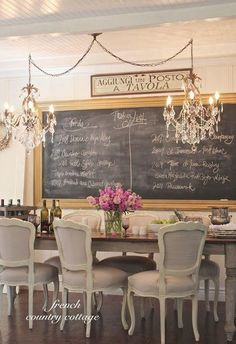 love chalkboards in kitchen & dining room spaces. Beautiful double chandeliers!