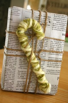 Yarn covered candy cane...so different in these colors and added to the gift wrap...add in a brown paper gift tag...LOVE it! :)