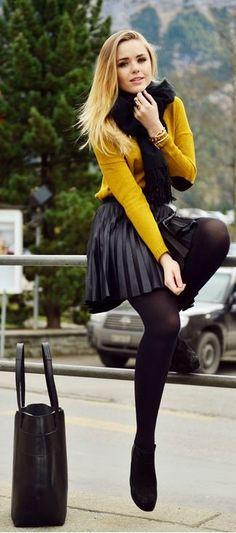 Adorable Fall Outfits - Black pleated short skirt top amber sweater and black legging and black scarf and black leather hand bag and boots