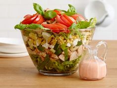 Get Summer Layered Salad with Grilled Chicken and Tomato Vinaigrette Recipe from Food Network