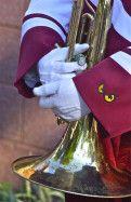 Holding close; Diamond Marching Band; Temple University; Philadelphia, Pennsylvania, USA.  October 2013.
