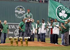 Paul Pierce celebrating the Celtics 2008 NBA Finals championship on the mound at Fenway Park.