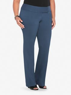 These essential and versatile slate blue pants are fashioned from lightweight rayon. We love the streamlined silhouette of the slim boot that is fitted through the thighs with a leg-lengthening slight flare at the knee. Faux pockets. Tab waist band.Pairs perfectly with our Ruched Sleeve Blazer (SKU 10160000) for a truly sophisticated suit.