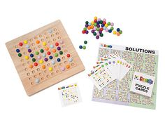 COLORKU | A colorful spin on Japanese logic puzzles, this wooden board uses marbles instead of numbers to solve each game. | UncommonGoods