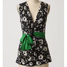 Ric Rac floral top Flattering black and white floral top. Sleeveless and has an attached green ribbon that ties in front. Like new! Anthropologie Tops