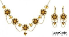 14K Yellow Gold over .925 Sterling Silver Jewelry Set: Necklace and Earrings by Lucia Costin with Suspended Chains, Flower and Fligree Ornaments, Garnished with Yellow, Brown Swarovski Crystals and Falling Chains Lucia Costin. $209.00. Handmade in USA unique jewelry set. Garnished with topaz and brown Swarovski crystals. Dangle ornaments accented with floral design. Style takes wings in this lovely jewelry set that have a graceful flower shape. Floral set of jewelry...